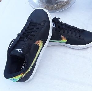 Women's Black and Gold Nike Sneakers